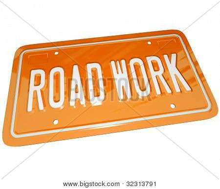 An orange metal license plate with the words Road Work communicating that there is roadwork ahead and construction is creating detours and traffic congestion