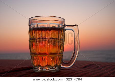 Glass Of Beer In Front Of A Sunset