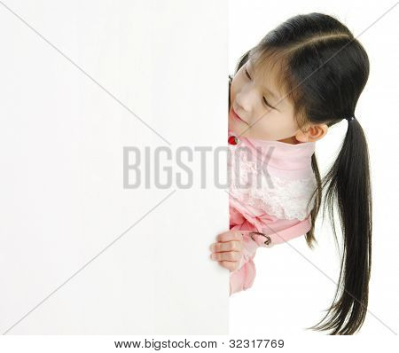 Little pan asian girl looking at white blank card