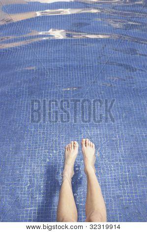 Woman's feet in pool