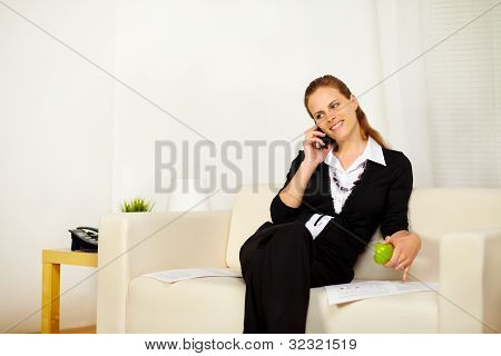 Friendly Young Business Woman Working On Sofa