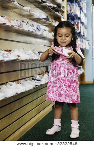 Young Hispanic girl at shoe store