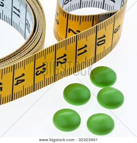 tape measure and tablets, as a symbol for diet pills. remove