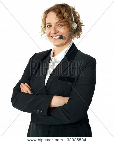 Smiling Female Operator With Crossed Arms