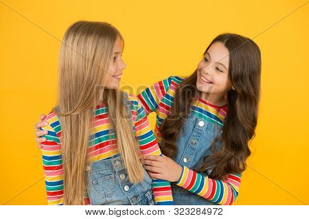 poster of Blonde And Brunette. Healthy And Shiny Hair. Kids Cute Children With Long Hairstyle. Hairdo Tips. Lo