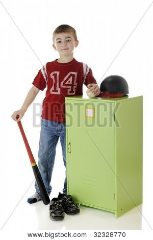 A handsome young elementary baseball player standing by his locker with his ball, helmet, bat and sneakers.  (Tag on locker left blank for your text.)  On a white background.