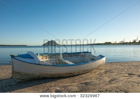 Blue and white clinker dinghy.