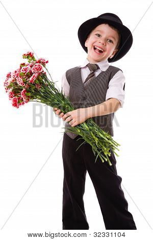 Happy boy with a bouquet of carnations