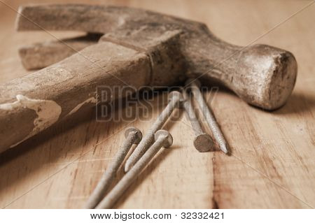 Hammer and nails in vintage light