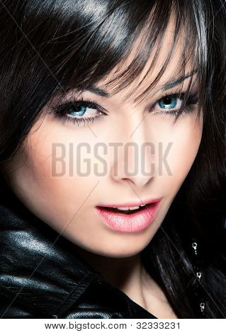 beautiful black hair young woman with blue eyes