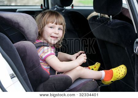 happy child in carseat