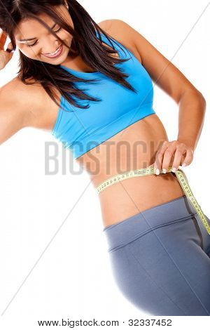 Woman measuring her waist - isolated over a white background