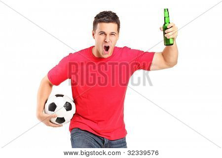 A portrait an euphoric fan holding a beer bottle and football cheering isolated on white background
