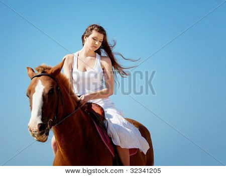 Girl With Horse On The Beach