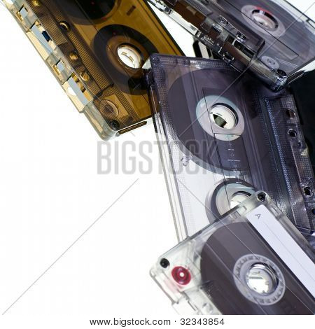 Heap of Compact Cassettes on white background