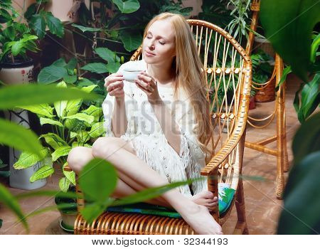 Girl With Cup Of Tea In Garden
