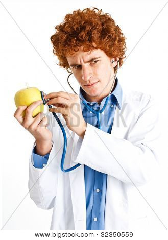 Portrait of a funny doctor examining an apple