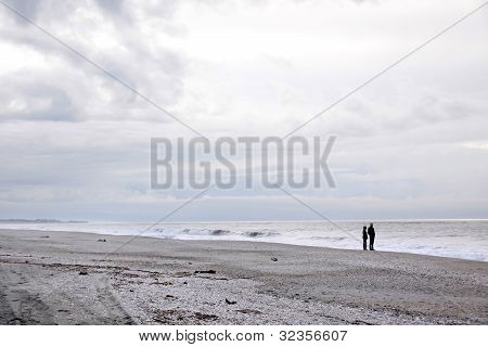 Couple At Lonely Beach