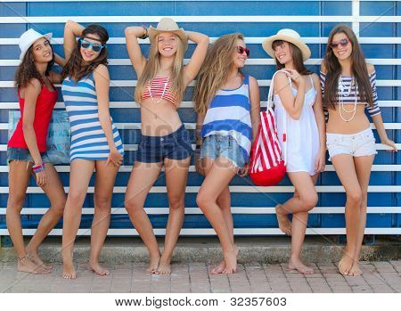 teens girls in beach wear at summer vacation or spring break