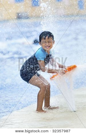 Asian Boy Having Fun At A Waterpark