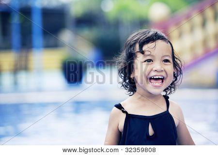 Happy Cute Girl At Swimming Pool