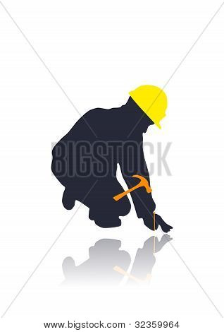 silhouette of a worker with a tool