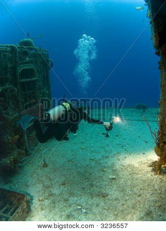 Underwater Photographer With Strobe Firing