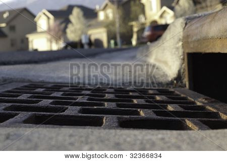 Vew Of Gutter And Storm Drain In Neighborhood