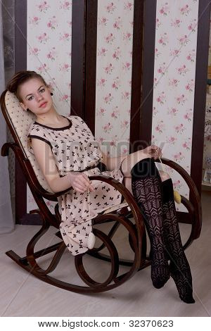 A girl in a high chair