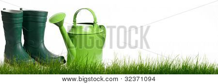 Extra large horizontal strip of grass and garden tools on white background.