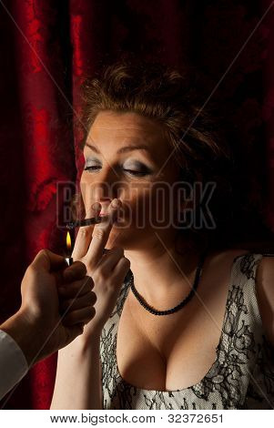 Man Gives Fire To Light Up A Cigarette Woman