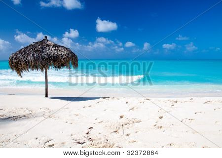Beach Umbrella On A Perfect White Beach In Front Of Sea