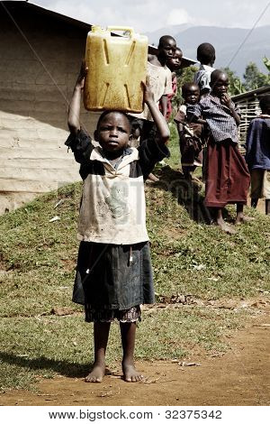 MSmall African Child Carrying A Jerrycan