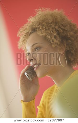 Young African woman using cell phone