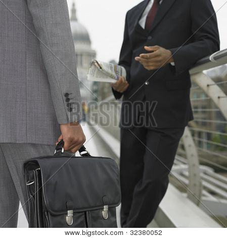 Two businessman talking outdoors