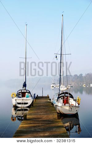 Pleasure Yachts Moored On Rustic Jetty