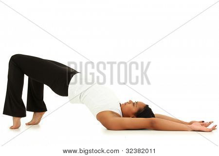 Beautiful Young Black Woman Doing Yoga Over White Background Barefoot in Sportswear