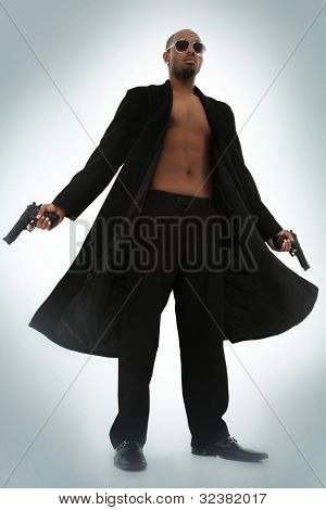 Matrix Style Role Play Character Adult Man in Trench Coat with Pistols over blue foggy background