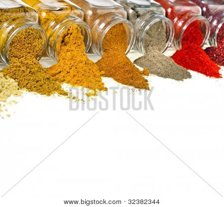 border of aromatic powder spices in glass bottle isolated