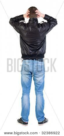 Back view of shocked man in jacket .   upset young guy in jeans and  jacket. Rear view people collection.  backside view of person.  Isolated over white background.
