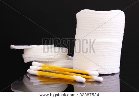 Cotton swabs and sticks isolated on black