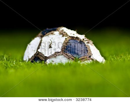Old Soccer Ball On Grass