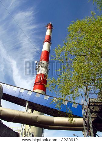 Chimney, Wharf, Pipelines, Tree And Sky