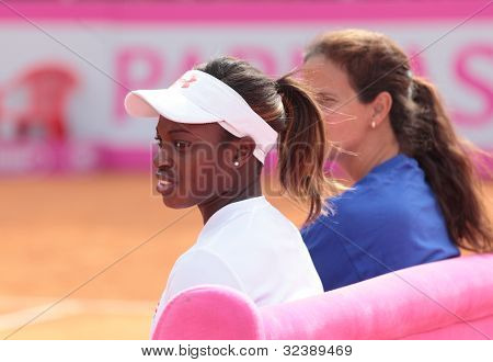 KHARKIV, UKRAINE - APRIL 19: Sloane Stephens and Mary-Joe Fernandez watch training during Fed Cup Tie between USA and Ukraine in Superior Golf & Spa Resort, Kharkiv, Ukraine at April 19, 2012