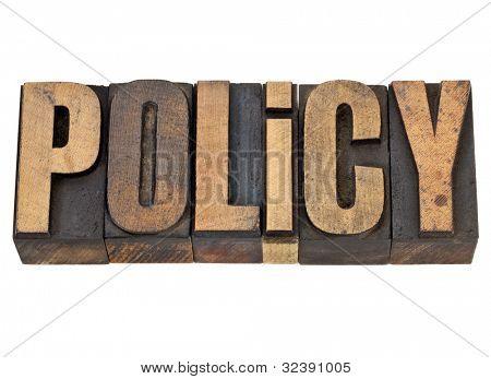 política - uma palavra isolada em madeira tipo de tipografia vintage