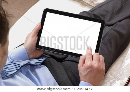 Businessman relaxing whilst working on digital tablet with blank white screen for copy