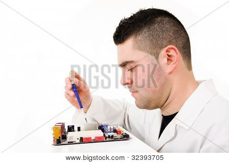 Computer Engineer repairing a motherboard , isolated over white background