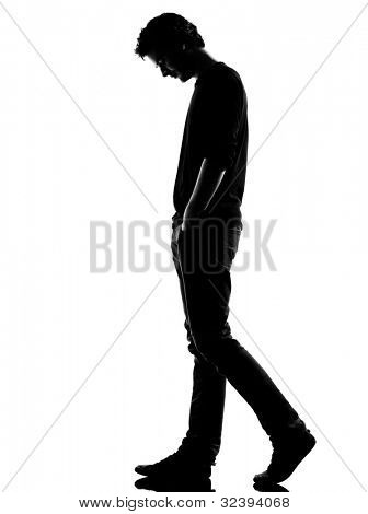 young man sad walking silhouette in studio isolated on white background