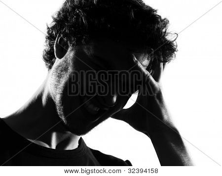 young man headache sadness portrait silhouette in studio isolated on white background