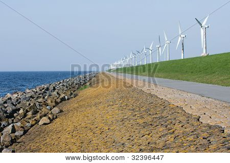 .endless Dike With Windmills In The Netherlands.